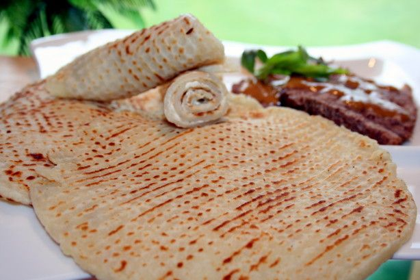 This is the best Lefse you will ever taste!  I have such wonderful memories of learning how to make lefse at my Aunt Gwens. She makes this with authentic, hand made Norwegian rolling pins and lefse sticks made by her father and handed down to her by her mother. Do not fear though! Lefse can be made with regular kitchen equipment like a rolling pin and thin spatula. Traditionally this is served warm with butter or for a treat with cinnamon, sugar or jam. My family always enjoys their lefse…