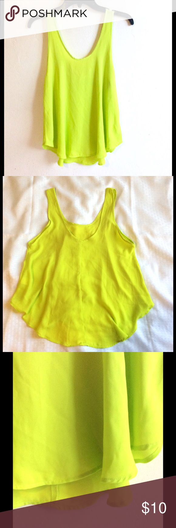 """LUSH Lime Green Floaty Circle Cut Poly Tank Top LUSH, Size Medium, Lime Green polyester Tank Top, wide circle cut for a Floaty look, perfect over shorts and jeans. Measures 17"""" armpit to armpit, 24"""" at longest Point. Coachella is soon, get your wardrobe started! LUSH Tops Tank Tops"""