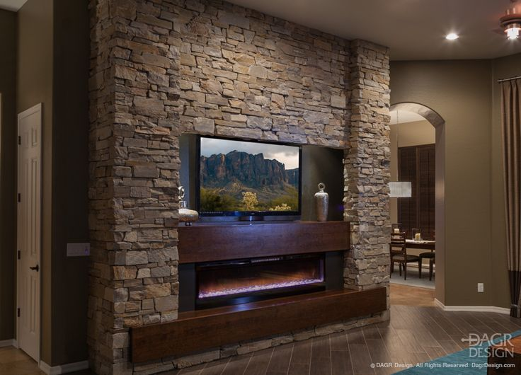 Contemporary entertainment center design with natural stacked stone and a modern gas fireplace by DAGR Design