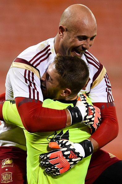 Pepe Reina Photos Photos - Pepe Reina of Spain hugs his teammate Sergio Ramos during a training session of the Spain National Team at the Robert F. Kennedy Stadium on June 4, 2014 in Washington, DC. - Spain Training Session