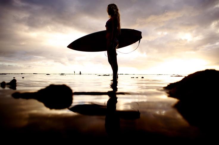 Surf woman sunset superhero