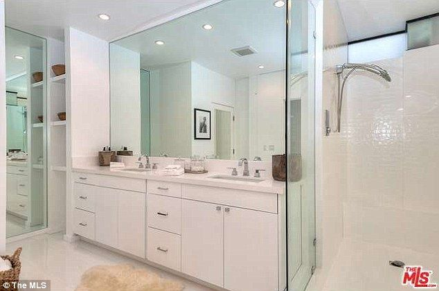 Never a fight again: The almost 5000-square-foot property has five and a half bathrooms...