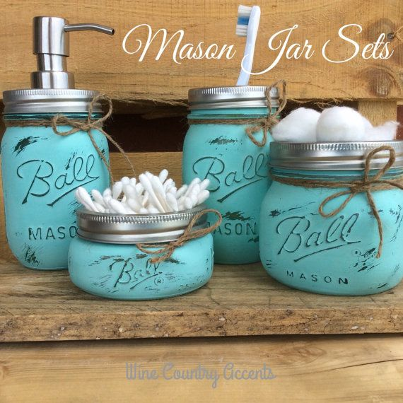 Add some unique charm to your bathroom decor with this Teal Mason Jar Bathroom Set. Each jar is hand painted, distressed and sealed. Perfect