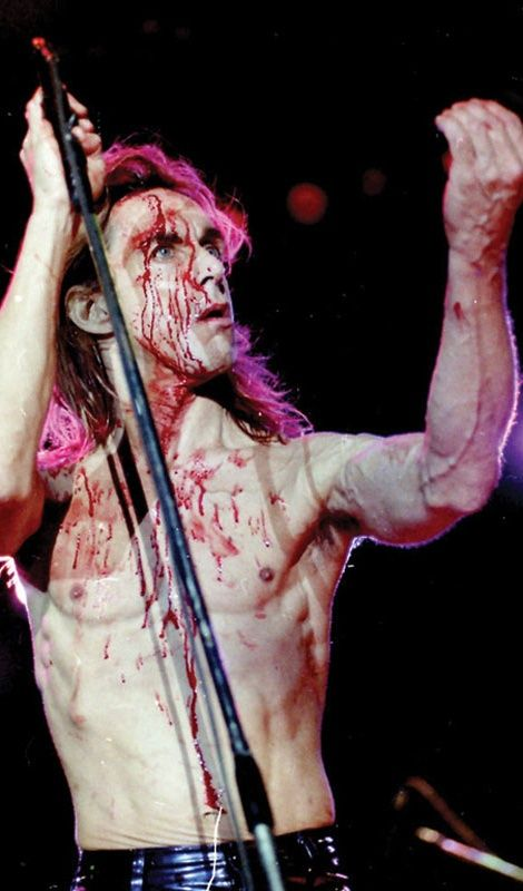 "Iggy Pop covered in blood after been hit with a bottle during his wild performance at the ""Rock Of Gods"" festival, held at the port of Piraeus, Greece, in 1996 (photos by Giorgos Mouratidis)."