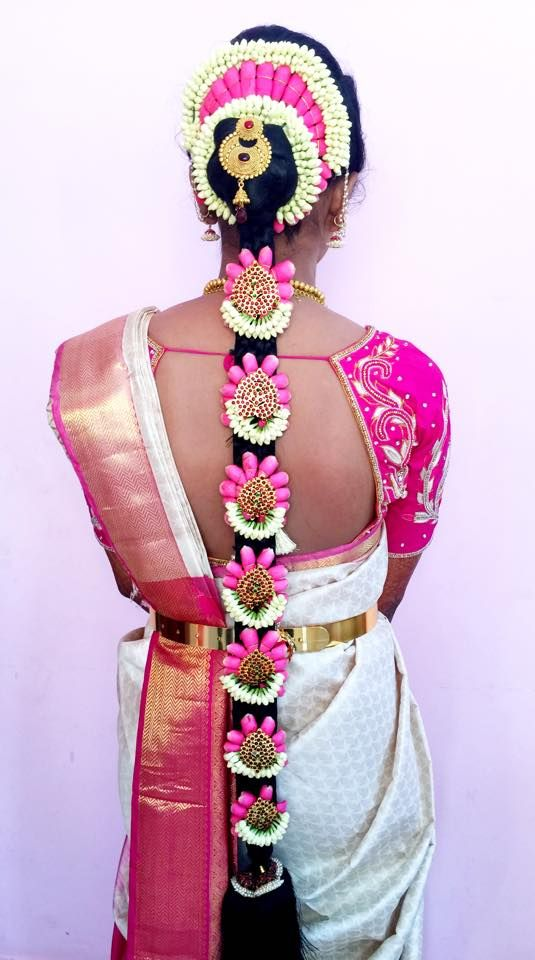 South Indian bride. Temple jewelry.Pink and white silk kanchipuram sari.Braid with fresh flowers. Tamil bride. Telugu bride. Kannada bride. Hindu bride. Malayalee bride.