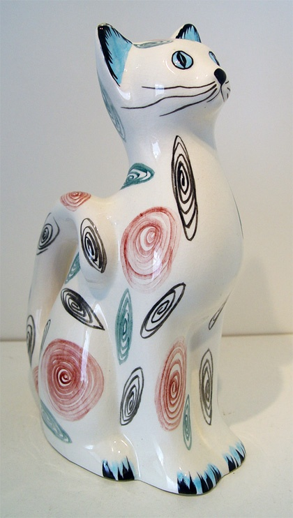 Swirl decorated pottery cat. Impressed 'England' on base. c.1960's. White Cat Figurine with Pink Blue and Black.