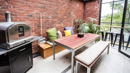 Chantelle & Steve's loungeroom terrace- includes a pizza oven; a wall...
