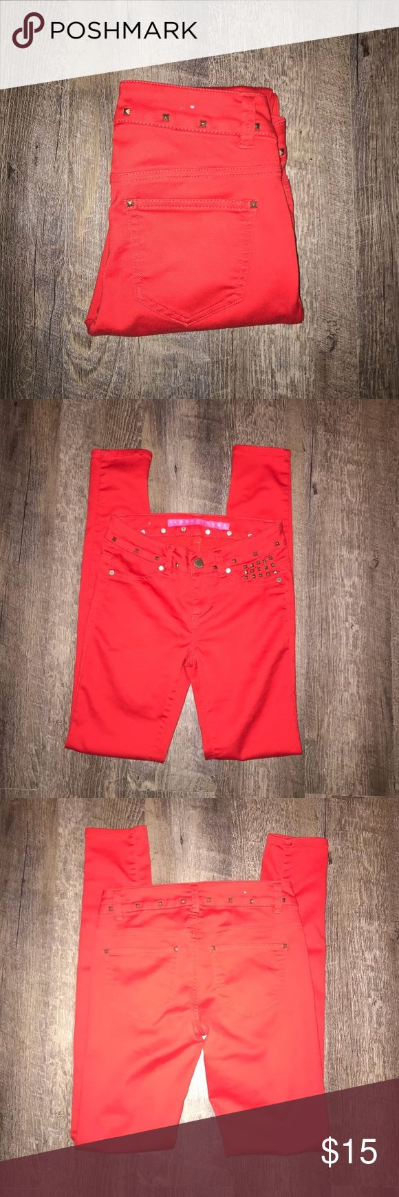 Tinseltown Women Red Skinny Pants Tinseltown Women Red Skinny Pants In excellent condition with stud around waist of pants.  Size: 0 Color: Red Tinseltown Pants