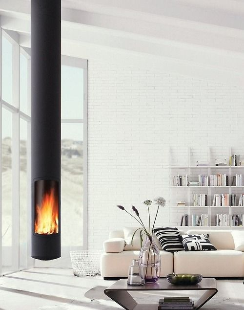 Fabulous columnar fireplace suspended from ceiling. Simple, Scandinavian design