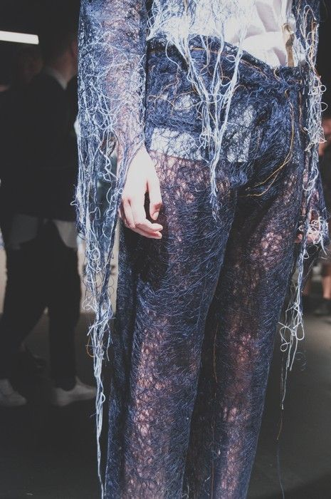 A mesh of threads at Faustine Steinmetz SS15 LFW. More images here: http://www.dazeddigital.com/fashion/article/21665/1/faustine-steinmetz-ss15