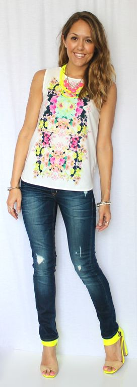 Another great printed top with bright colors. I love how she popped the color with her necklaces, and what fun shoes.