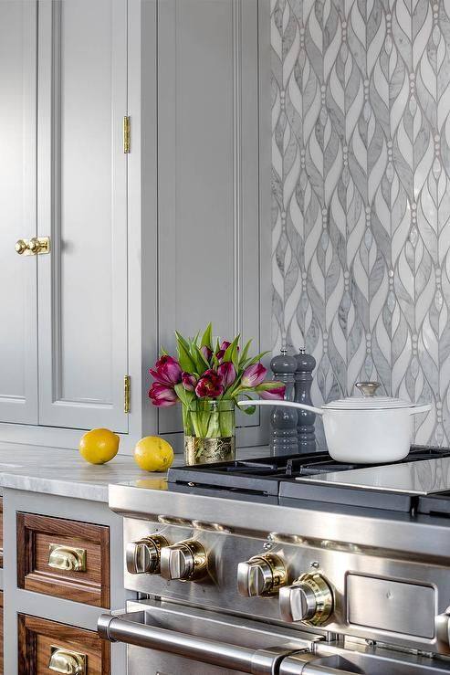 light gray shaker cabinets in a transitional kitchen boasting white rh pinterest com