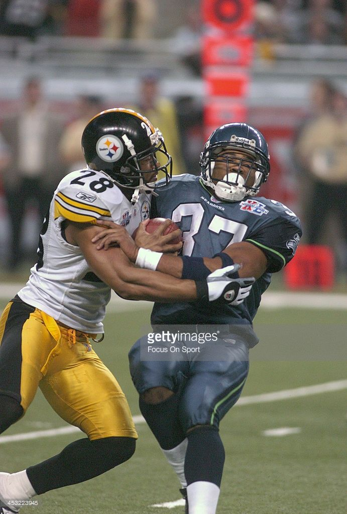 Shaun Alexander #37 of the Seattle Seahawks gets tackled by Chris Hope #28 of the Pittsburgh Steelers during Super Bowl XL February 5, 2006 at Ford Field in Detroit, Michigan. The Steelers won the game 21-10.