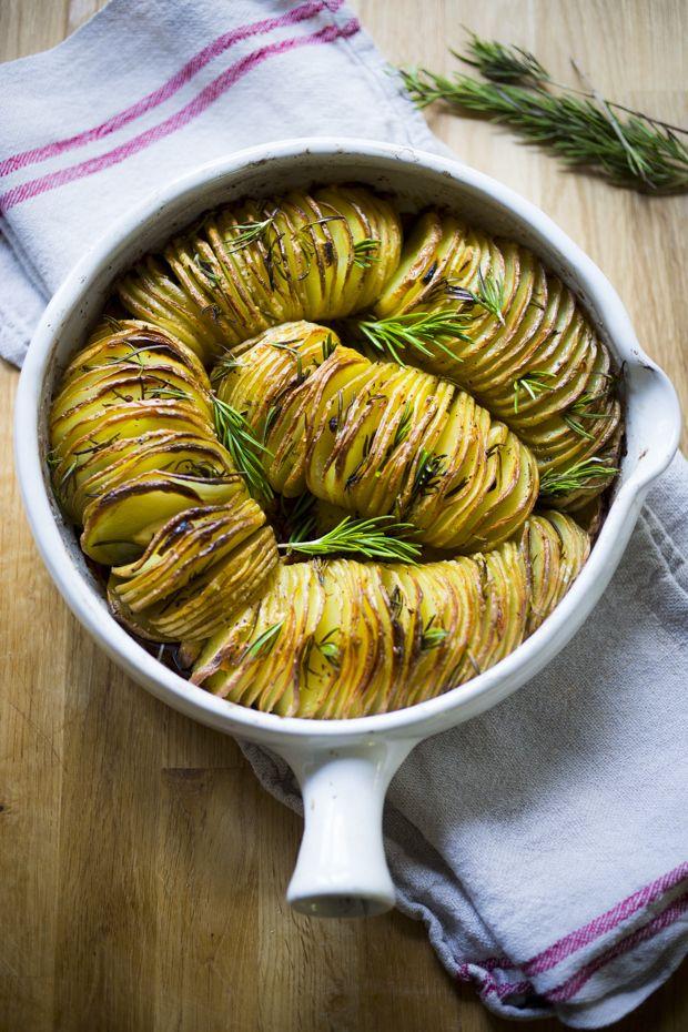 Rosemary Garlic Hasselback Potatoes...deliciously crispy, tender, flavorful! | www.feastingathome.com