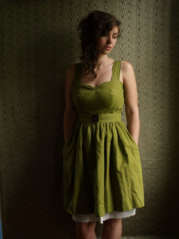 Hand dyed Linen garden dress with sewn in eyelet petticoat, pockets and handmade wooden buttons.