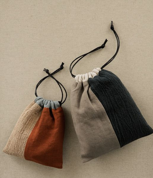 Pouch, by Tsuchiya Orimono sho, crafted of hand-woven cotton, silk and linen at her studio in Nara, Japan   ::  via Analogue Life