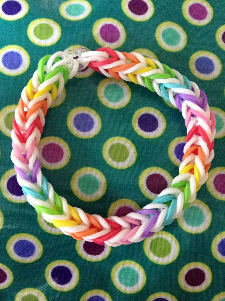 Rainbow and white rainbow loom rubber band bracelet -- I like the way the colors break up with the white - More on loom  rubber bands + designs visit: http://www.overtherainbowloombands.com