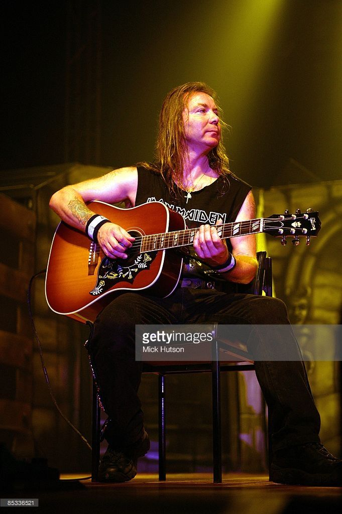 FORUM Photo of Dave MURRAY and IRON MAIDEN, Dave Murray performing live onstage, playing Gibson Hummingbird acoustic, copyright Getty Images