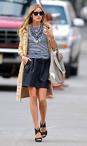 Olivia Palermo wore a tiered camel coat, tulip skirt, striped t- shirt and a statement necklace.