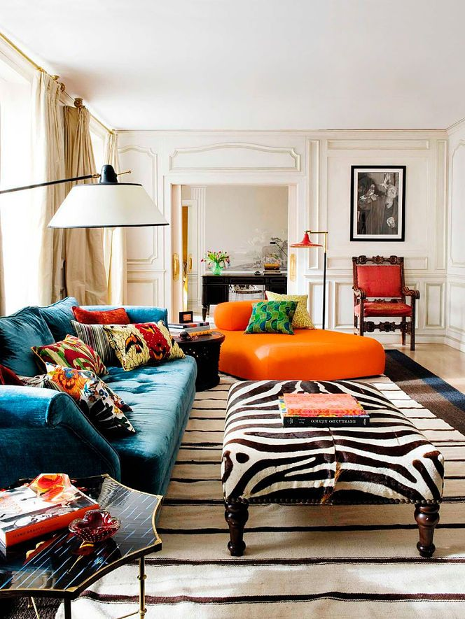 Bold Colorful Home Decor Inspiration | Living Room Decorating Ideas | Orange Chair | Zebra Ottoman | Blue Velvet Couch