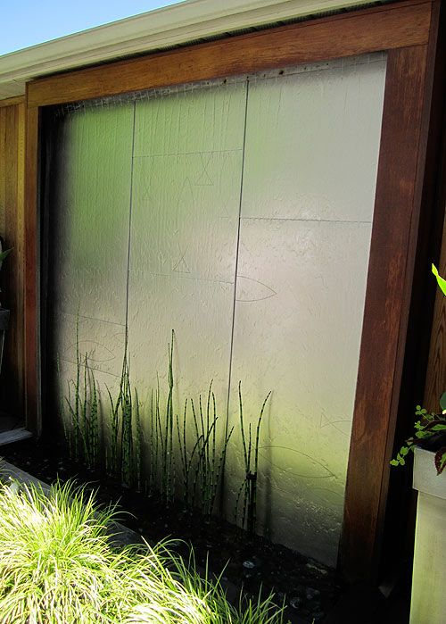 This water feature at 51 Northern Dancer Blvd. (and the garden) were designed by Kim Price Landscape. It cleverly hides the garage that is mere steps from the back door of the house.