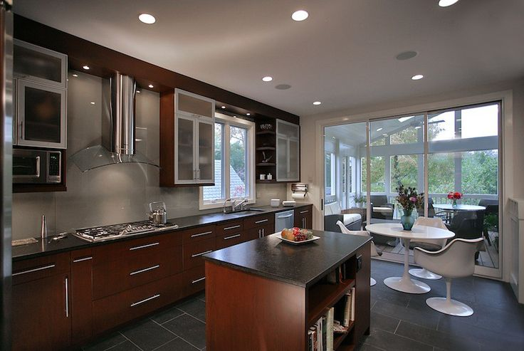 Minimalist kitchen contrast colours of wooden plate dark brown
