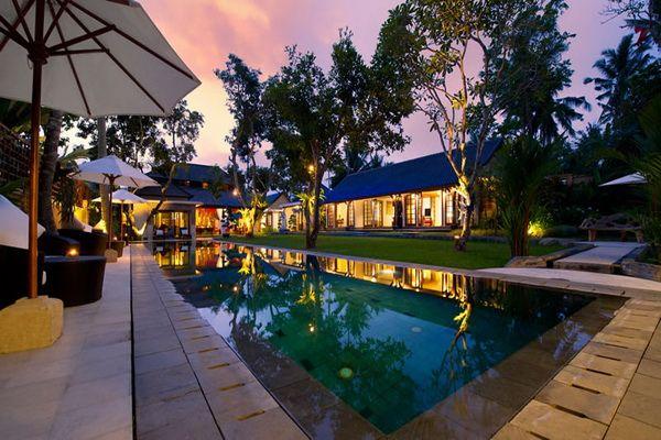 villa san pool and villa at dusk