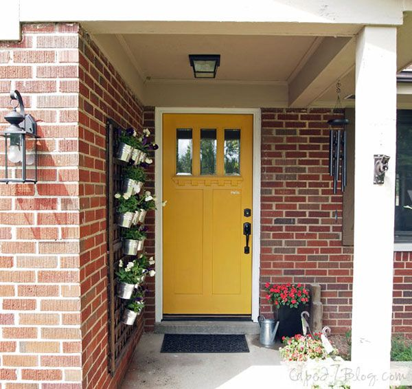 Love the yellow door and the DIY Vertical Wall Planter, via Cape 27