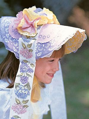 Fun Easter Bonnet made from poster board, mini-muffin cups, ribbon and doilies.