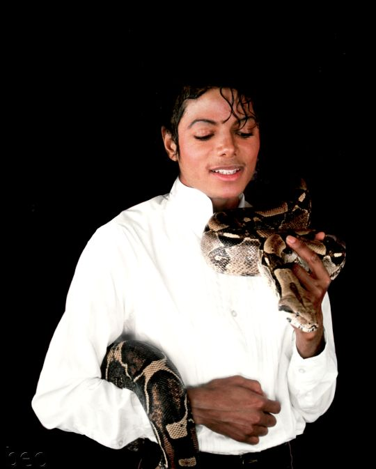 Michael with his beloved pet snake Muscles ♡