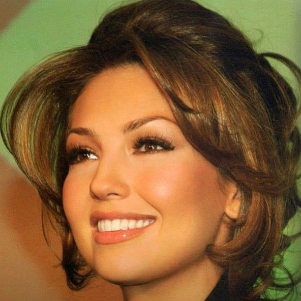 Thalia. Subtle makeup and beautiful teeth