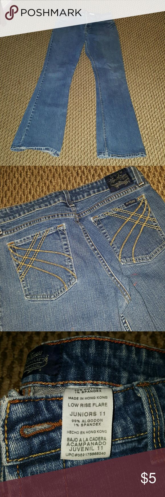 Juniors Low rise jeans Juniors Low rise flare jeans with 3 button as shown in picture, worn a few times, as shown in picture there is nail Polish stain on the back, these are gonna be listed cheap. levi Strauss  Jeans Flare & Wide Leg