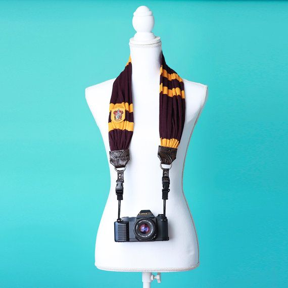 Capture all your summer memories with the help of a Gryffindor scarf camera strap!