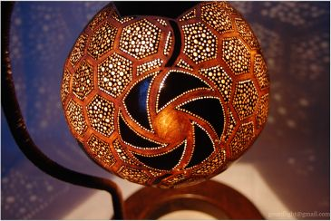 Lampshade is made of gourd. The base is made of wood. The stand is finished off with waxed string. Diameter of gourd is 18 cm, lamp is 39 cm high. SOLD!