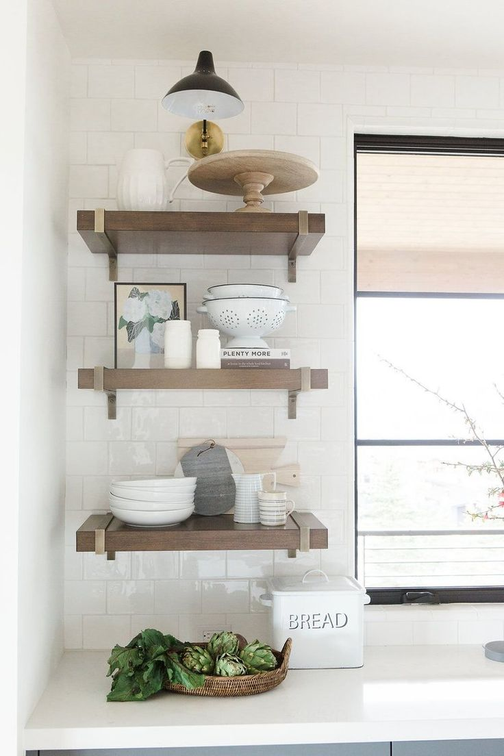 Dark walnut open shelving with kitchen accessories