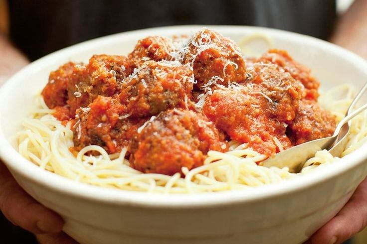Balsamic and red wine add a depth of flavour to Katie Quinn Davies' thick tomato pasta sauce, perfect with chunky meatballs.