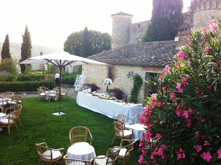 Cocktail hour in the herb garden Castello di Meleto