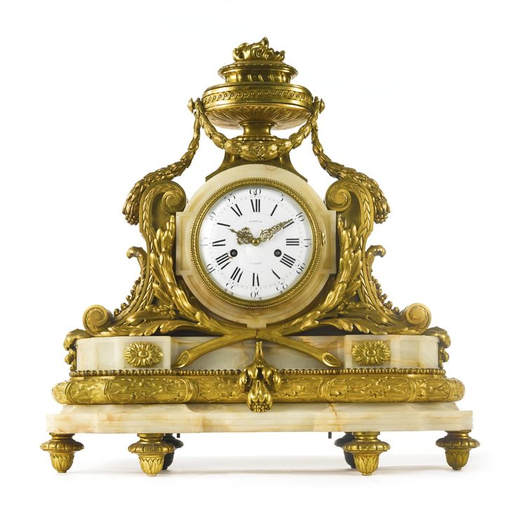gilt bronze and beige onyx mantel clock Paris, late 19th century the enamel dial with Roman and Arabic numerals and inscribed MARQUIS / A PARIS height 28 1/2 in.; width 28 1/2 in.; depth 9 1/2 in. 72.5 cm; 72.5 cm; 24 cm