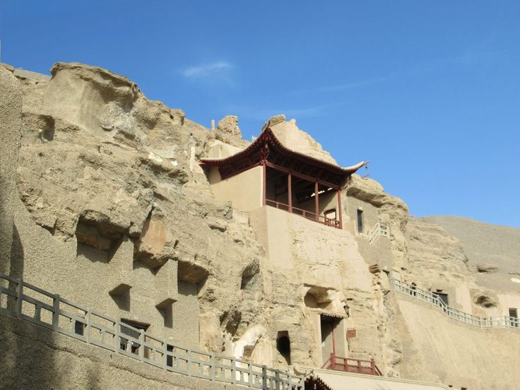The Mogao Caves contain as many as 2,415 statues and murals in 492 caves along a broken cliff southeast of Dunhuang, Gansu, China. It`s Chinas' richest storehouse of ancient Buddhist art.