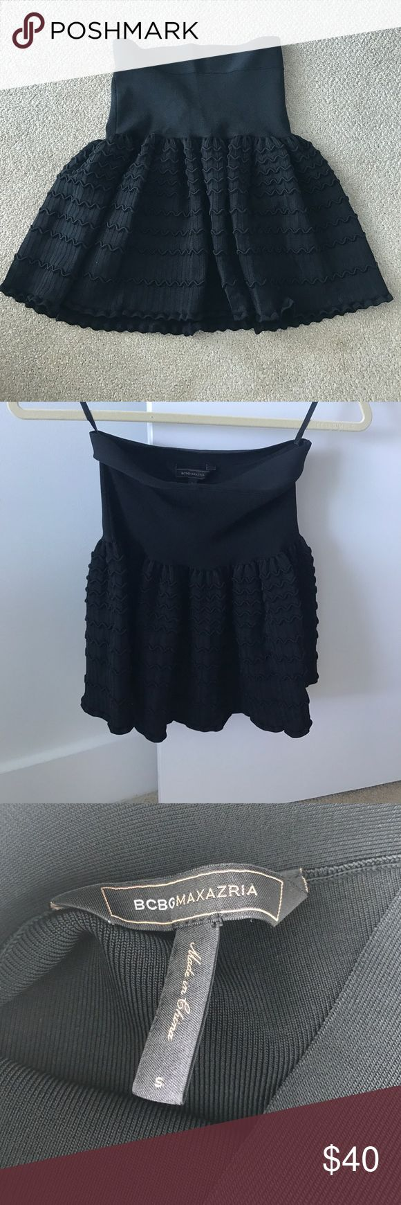 BCBG black skirt BCBG black skirt with peplum style. Fits adorable! Tight fit at the hip/ stomach and flowy on the bottom. Ruffle detail along the bottom. INCREDIBLE condition!! Worn ONCE. BCBG Skirts