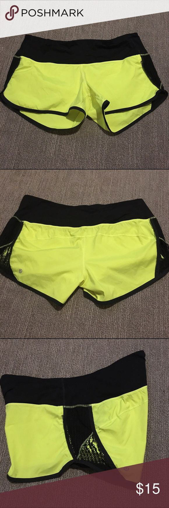 Lululemon Neon Yellow Athletic Shorts Lululemon Neon Yellow Athletic Shorts. Size 12. Has two pockets in the front and one zippered pocket on the side. Lace on sides has some rips in them (not the best idea to put lace on athletic shorts IMO). Otherwise great condition. Really comfy. Took the tag off because it was annoying. lululemon athletica Shorts