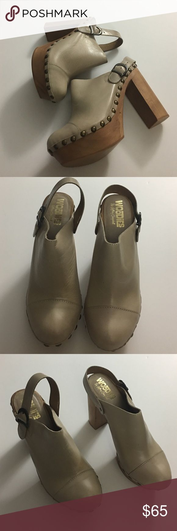Woodies By Jeffrey Campbell Beautiful clogs by Jeffrey Campbell shoes made in Spain. Beautiful bone color they have not been worn just tried on. Leather upper. No obvious imperfections. Jeffrey Campbell Shoes Mules & Clogs