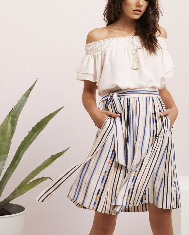 Look feminine and polished in this breezy tie-waist skirt colored with pretty pastel stripes.
