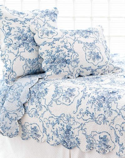 Blue and white bedding with scalloped edge! Perfect for a cottage home!