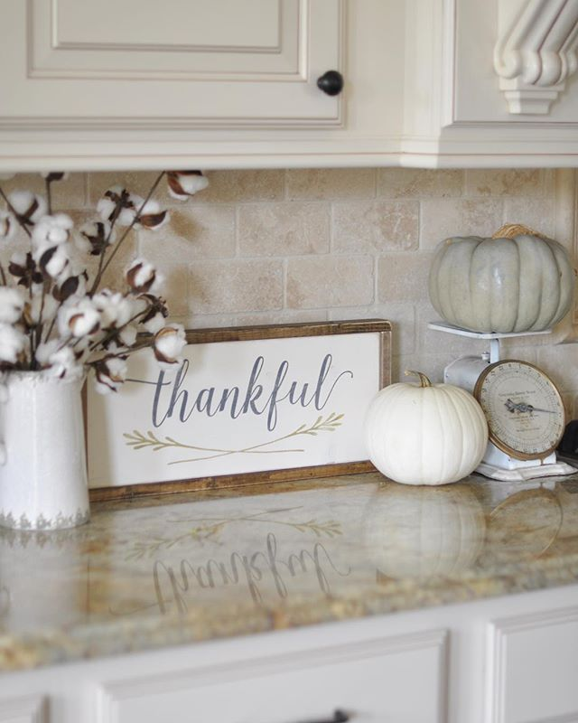 "This week the ladies hosting #OurGratefulHome want to see our #fallkitchen decor.  I received this precious ""Thankful"" sign in the mail yesterday from @charlie.and.ella, so I had to use it right away.  It ended up on my kitchen counter with my vintage scale, a couple of pumpkins, and my cotton stems from @paintedfox1, and I love it!  Yay for happy mail!"