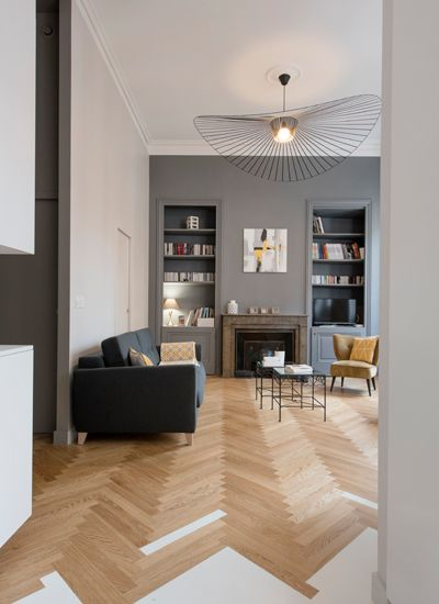 Blending parquet with a contrasting flooring material find this pin and more on deco
