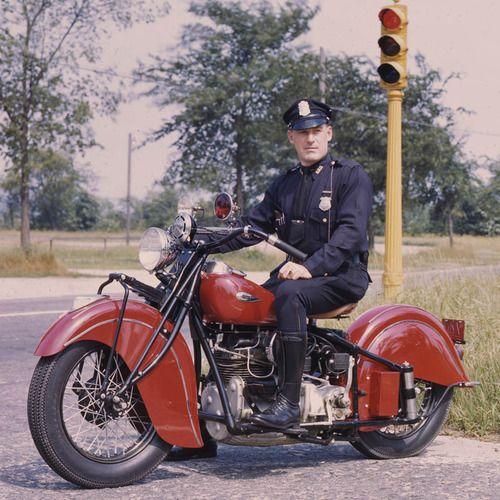 Motor officer on an unmarked Indian motorcycle.  police patrol cop motorcycle motor motorbike