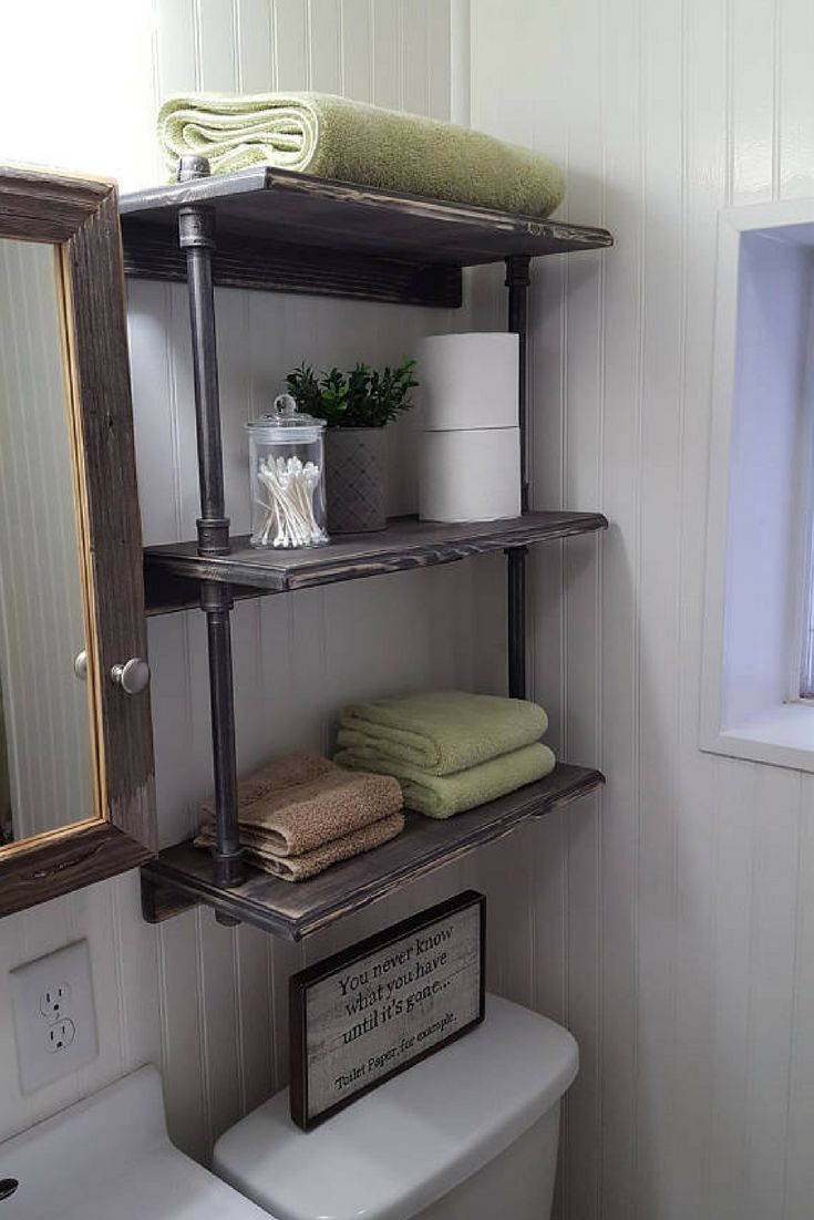 I LOVE this over the toilet shelf!!! It's got the industrial pipping that is awesome and it just looks great. Beats the cheap wire racks any day! This one isn't wobbly, that's for sure! #ad #homedecor #bathroomdecor #bathroomorganization #farmhousedecor #farmhousebathroom #rustisdecor #rusticbathroom #professionalpinner