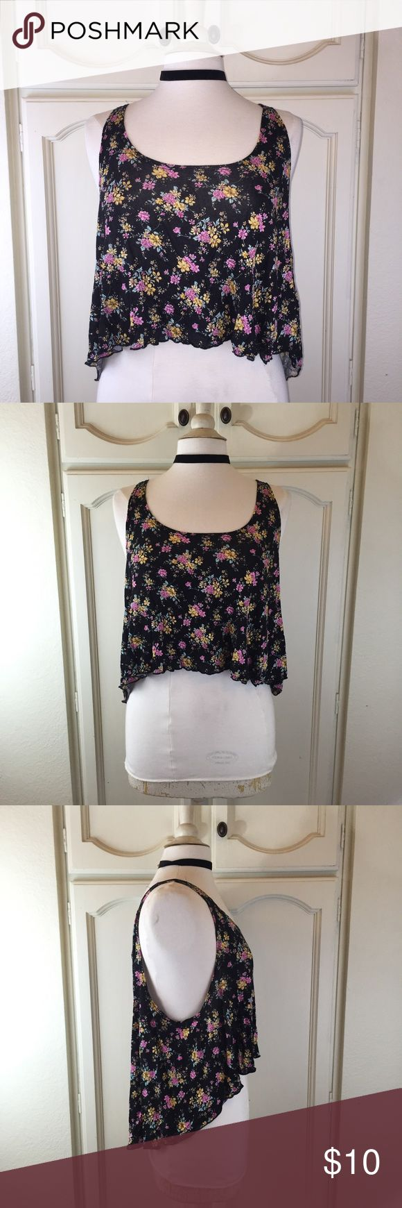 Floral Print Crop Top This cropped top is a needed basic for your spring wardrobe. Looks great with anything high waisted! Jeans, skirts, or shorts! In perfect condition only worn once! Tank top is black with yellow and pink flowers and green leaves Tops Crop Tops