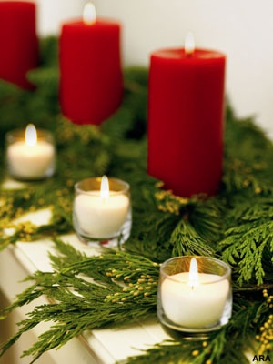 I like the simplicity here... Christmas Fireplace Mantel Decor Idea with Candles